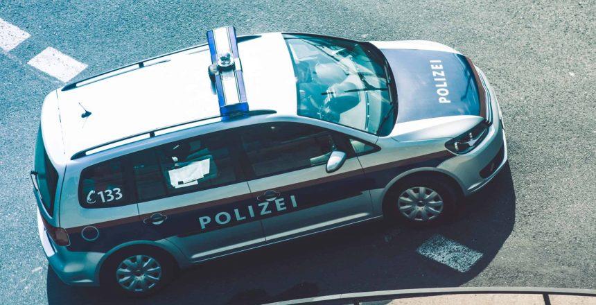 Federal Police Cruiser in Austria. Bird Eye View. Police Vehicle on the City Street. Polizei.