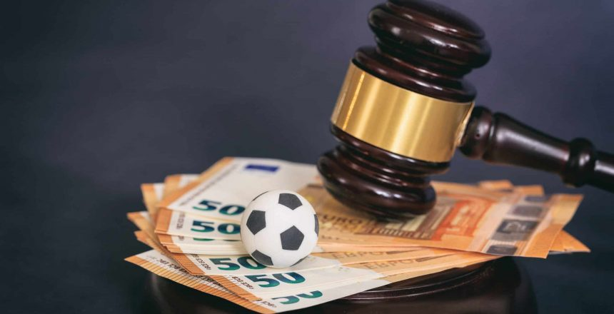 Judge gavel, football soccer ball and euro banknotes on black background