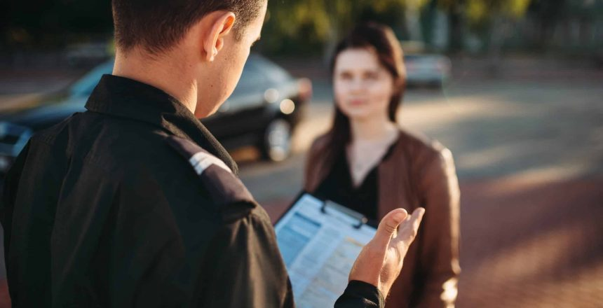 Police officers in uniform reads law to female driver. Law protection, car traffic inspector, safety control job